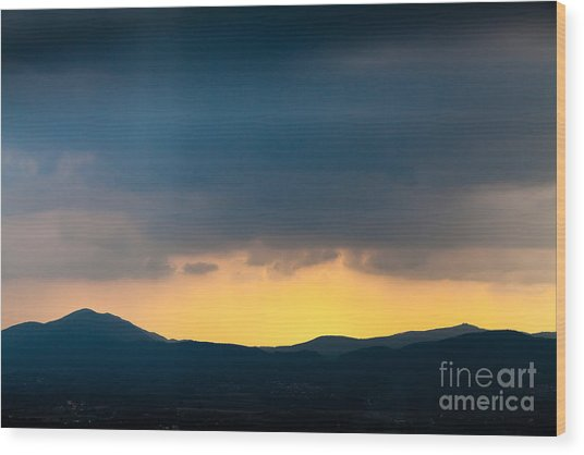 Overcast Dark Sky Rain Clouds With Yellow Glow Beyond Hills On H Wood Print