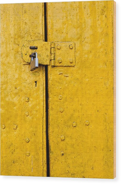 Padlock On An Old Yellow Door Wood Print
