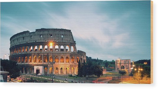 Panoramic Of The Colosseum At Night Wood Print by Matteo Colombo