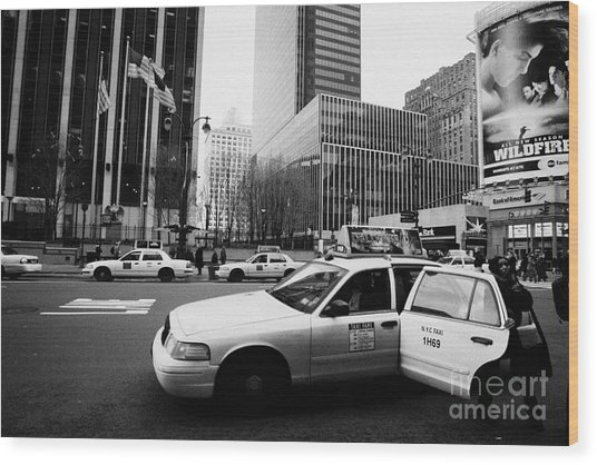 Passenger Gets Out Of Rear Door Of Yellow Taxi Cab On 7th Avenue New York City Usa Wood Print by Joe Fox