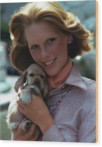Patti Hansen Carrying A Puppy Wood Print