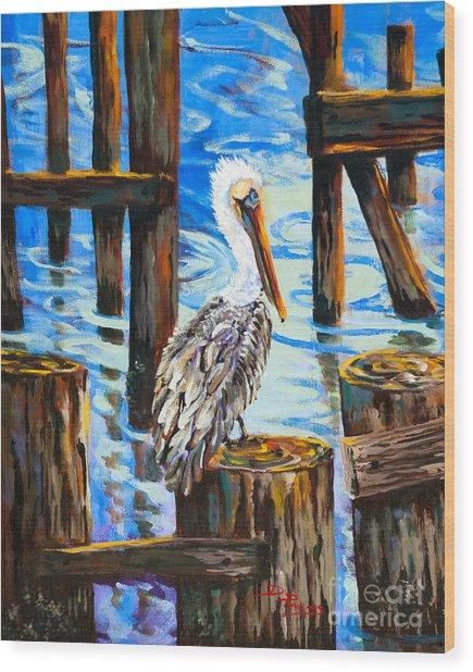 Pelican And Pilings Wood Print