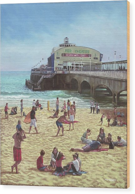 people on Bournemouth beach Pier theatre Wood Print