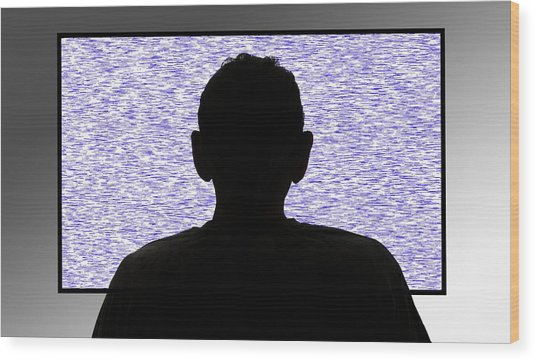 Person In Front Of Flickering Tv Screen Wood Print by Victor De Schwanberg/science Photo Library