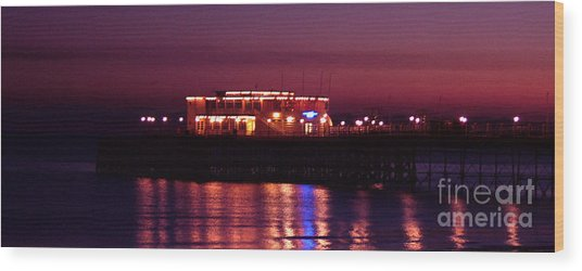 Pier By Night Wood Print by Mark Bowden