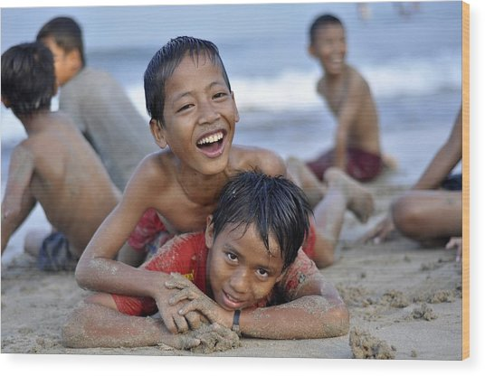 Playing On The Beach Wood Print by Achmad Bachtiar