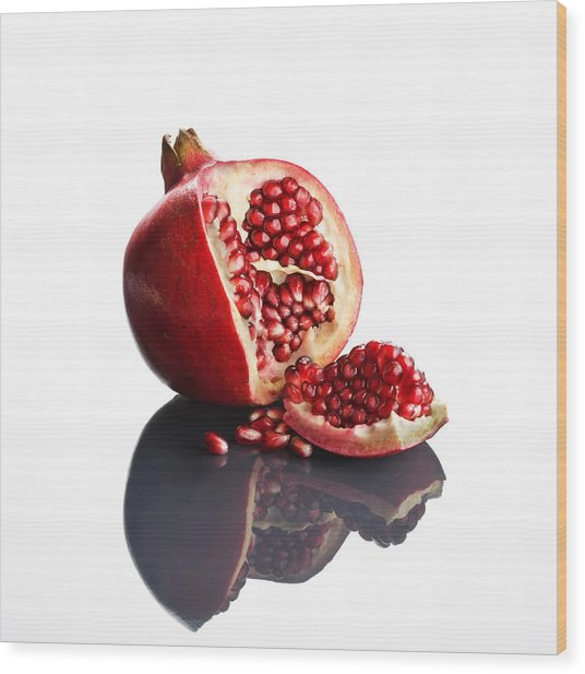 Pomegranate Opened Up On Reflective Surface Wood Print