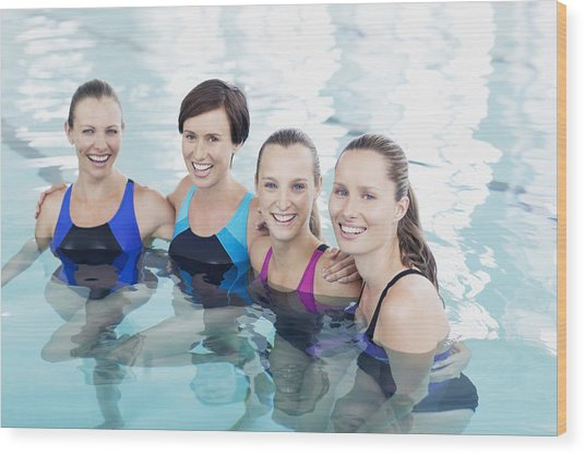 Portrait Of Smiling Women In Swimming Pool Wood Print by Robert Daly