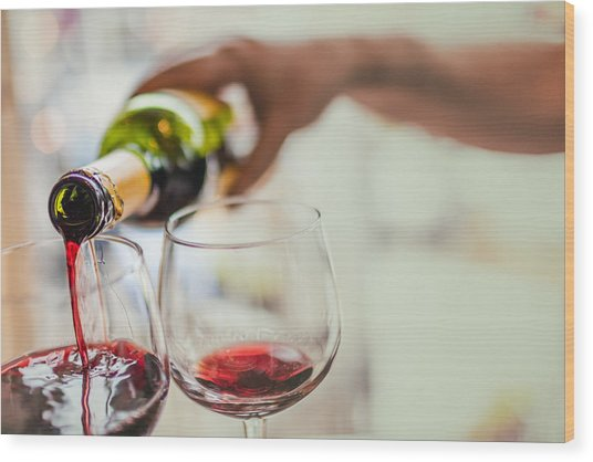 Pouring Red Wine In Glasses Wood Print by Instants