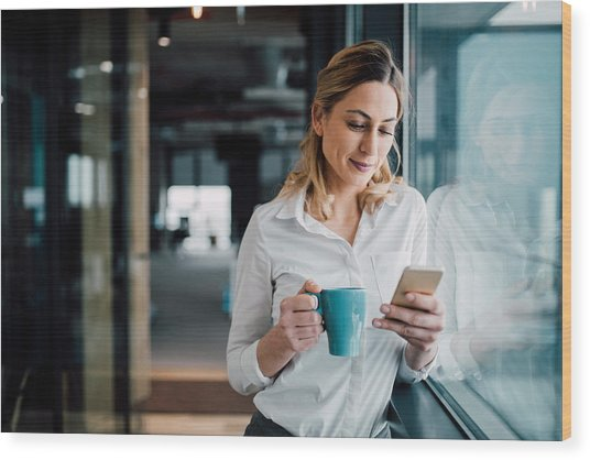 Professional Businesswoman Texting Wood Print by Filadendron
