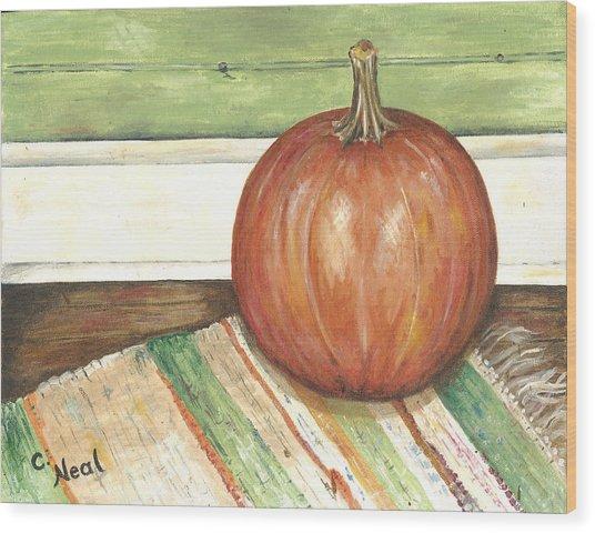 Pumpkin On A Rag Rug Wood Print