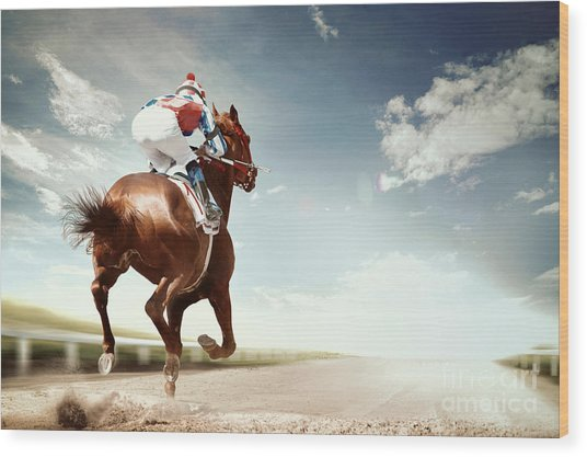 Racing Horse Coming First To Finish Wood Print