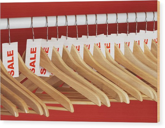 Rail Of Clothes Hangers With Sale Tags Attached, Close-up Wood Print by Martin Poole