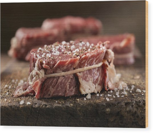 Raw Bacon Wrapped Steak Fillets Seasoned With Salt And Pepper Wood Print by Lauri Patterson