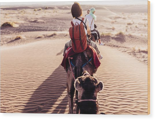 Rear View Of People Riding Camels In Desert Wood Print by Oscar Wong