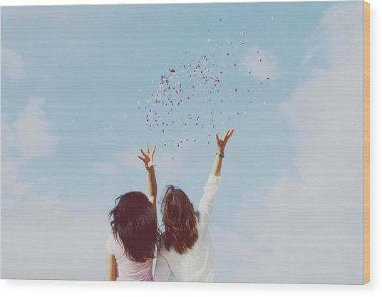 Rear View Of Women Throwing Confetti Wood Print by Raquel Perez Garrido / Eyeem