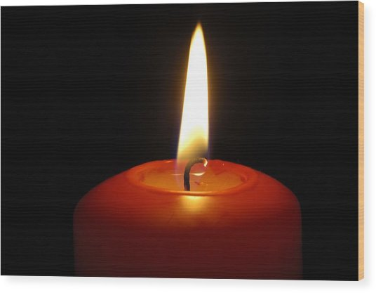 Red Candle Burning Wood Print