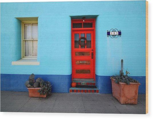 Red Door On Blue Wall Wood Print