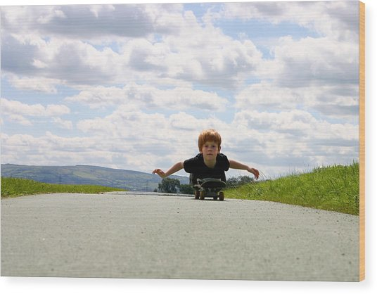 Red Headed Boy Skateboarding Wood Print by Image by Catherine MacBride