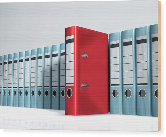 Red Lever Arch File In A Row Of Grey Files Wood Print by Artpartner-images