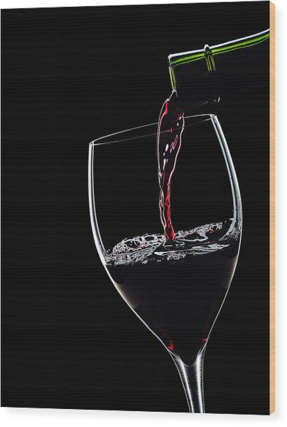 Red Wine Pouring Into Wineglass Splash Silhouette Wood Print by Alex Sukonkin