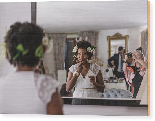 Reflection Of Bride Applying Lipstick While Standing In Front Of Mirror Wood Print by Adriana Duduleanu / EyeEm
