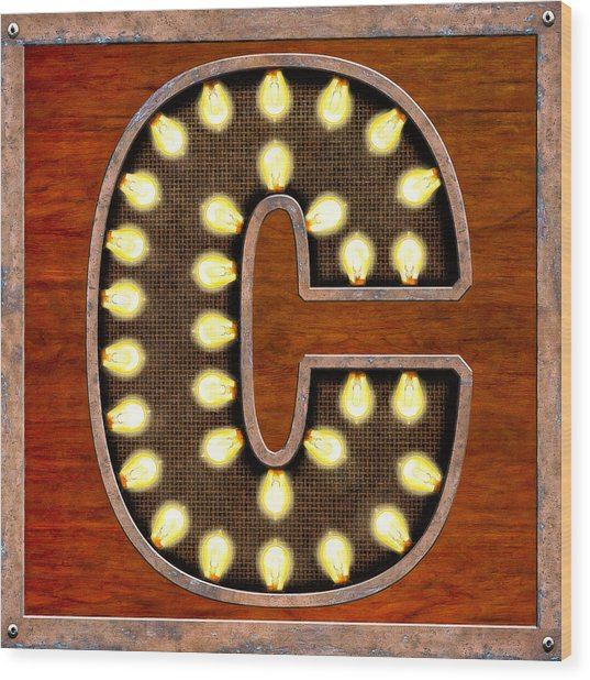 Retro Marquee Lighted Letter C Wood Print