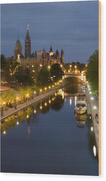 Rideau Canal And The Parliament Buildings At Night Wood Print by Rob Huntley
