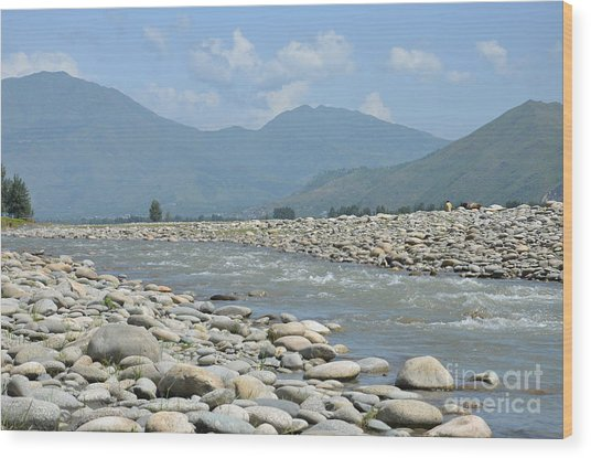 Riverbank Water Rocks Mountains And A Horseman Swat Valley Pakistan Wood Print