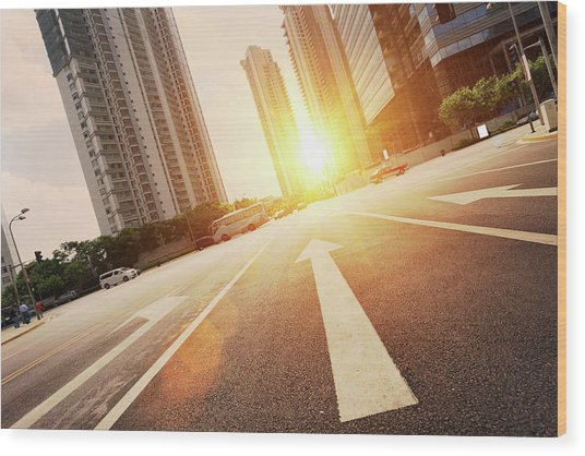 Road In City With Sunset Wood Print by Loveguli
