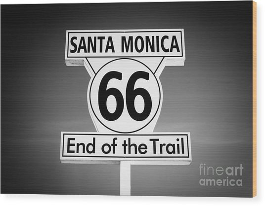 Route 66 Sign In Santa Monica In Black And White Wood Print by Paul Velgos