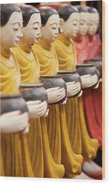 Row Of Buddhist Monk Statues Holding Wood Print