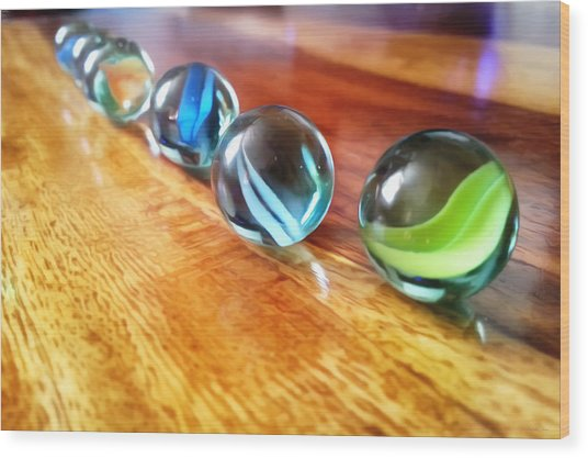 Row Of Marbles Wood Print