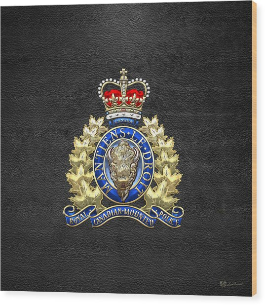Royal Canadian Mounted Police - Rcmp Badge On Black Leather Wood Print