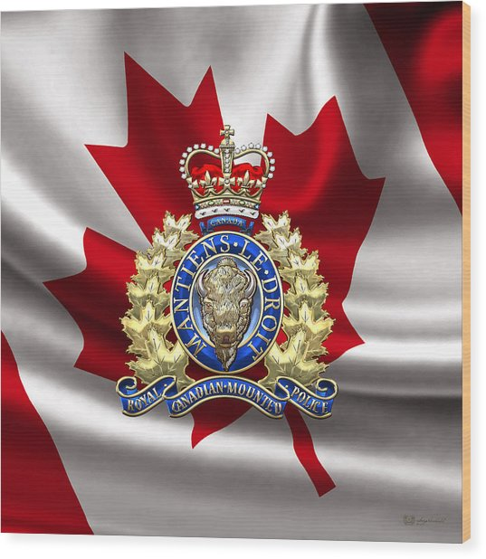 Royal Canadian Mounted Police - Rcmp Badge Over Waving Flag Wood Print