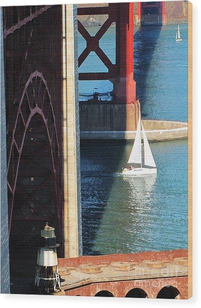 Sail Boat Passes Beneath The Golden Gate Bridge Wood Print