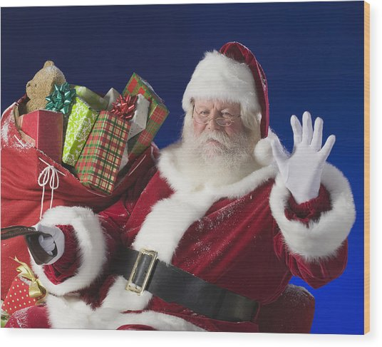 Santa Claus Next To Bag Of Toys Wood Print by Tetra Images