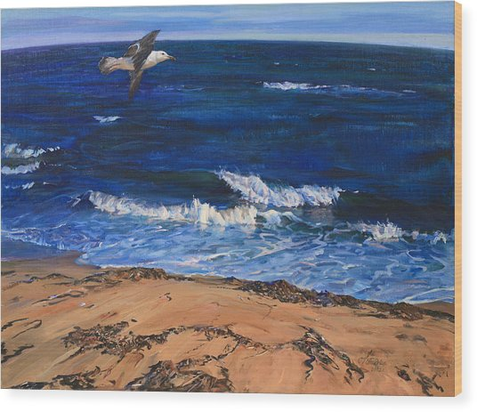 Seagull Flying Along The Surf Wood Print