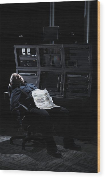 Security Guard Asleep In Office Wood Print by Thomas Northcut