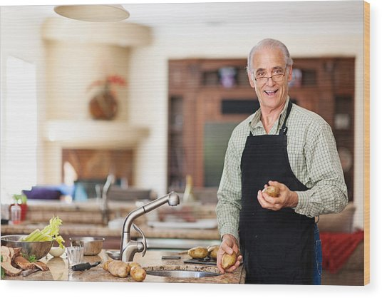 Senior Man Preparing To Wash Potatoes Wood Print by Lise Gagne