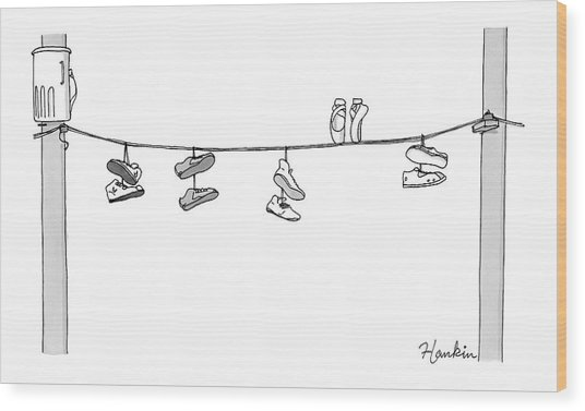 Several Pairs Of Shoes Dangle Over An Electrical Wood Print