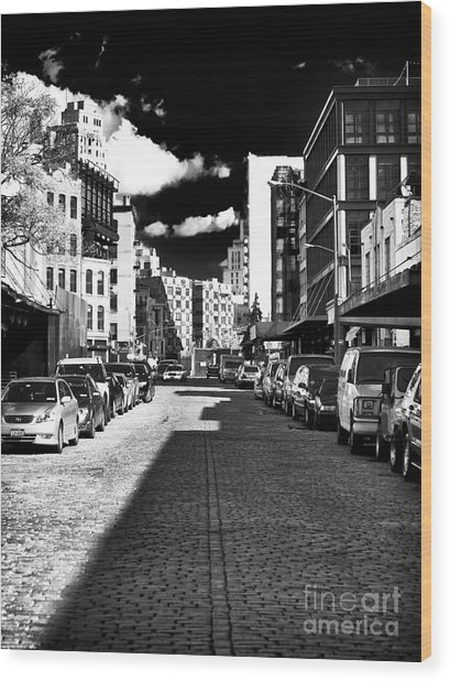Shadows On The Street Wood Print by John Rizzuto