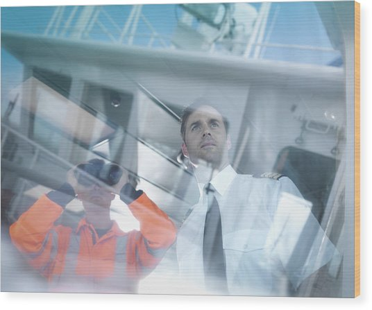 Ships Captain And Worker Seen Through Reflections On Container Ship Wood Print by Monty Rakusen