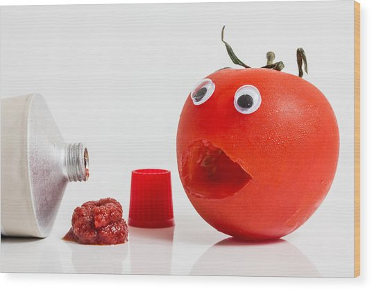 Shocked Tomato. Wood Print by Gary Gillette