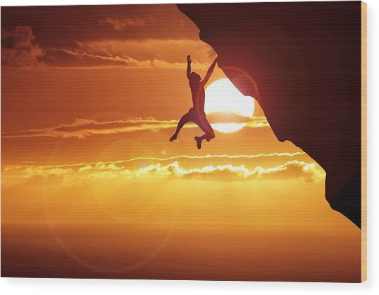 Silhouette Man Hanging On Cliff Against Wood Print