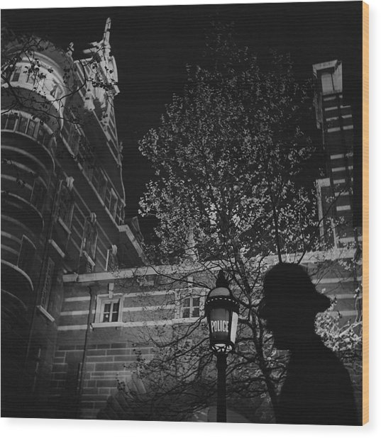Silhouette Of A British Policeman At Night Wood Print
