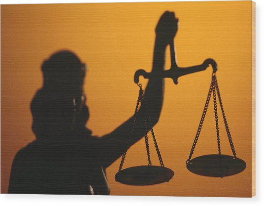 Silhouette Of Scales Of Lady Justice Holding Scales Wood Print by Comstock