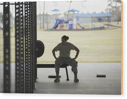 Silhouetted Female Soldier Barbell Training At Air Force Military Base Wood Print by Sean Murphy