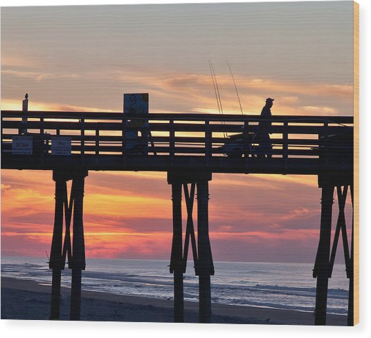 Silhouetted Fisherman On Ocean Pier At Sunrise Wood Print