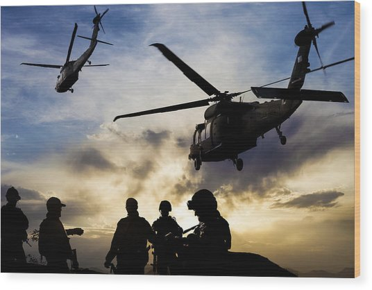 Silhouettes Of Soldiers During Military Mission At Dusk Wood Print by Guvendemir